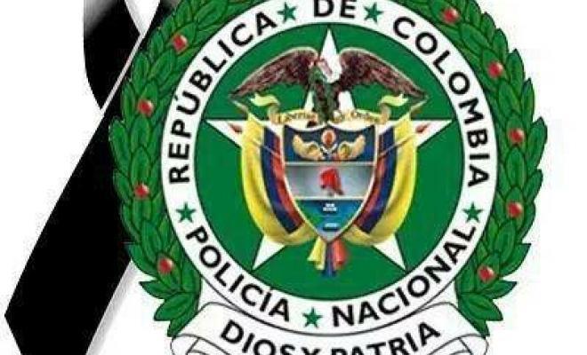 imagen del escudo de la policía con una cinta negra de luto